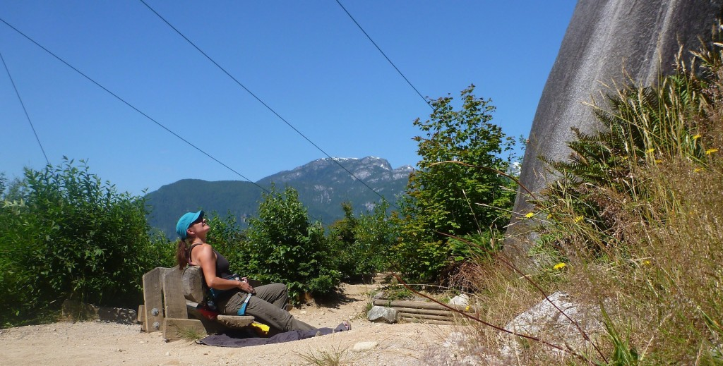 Pauline contemplating a climb in the unbelievably comfortable belay bench at Squamish...we do 5 star here!